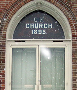 "Notice the faded initials ""C.P."" above the doors of the southern narthex of our sanctuary which reflects our early Cumberland roots within the Presbyterian denomination"